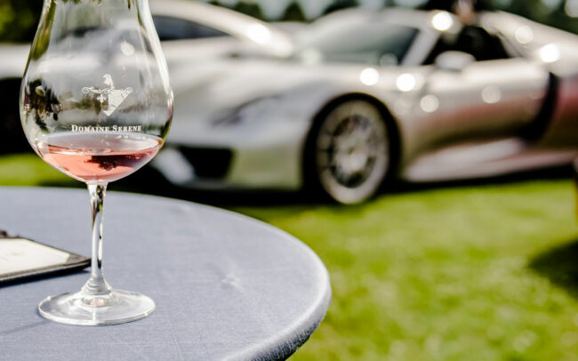 Domaine Serene logo glass with cars in the background