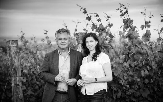 Man and woman standing in the vineyard