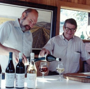 Dick Erath and Cal Knudsen pouring wine
